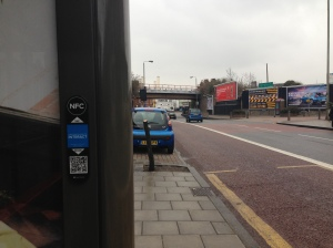An NFC bus shelter in a deserted London street. Do they seriously think that anyone will tap on this?
